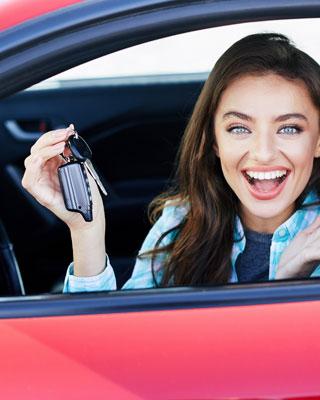 A happy women with car keys